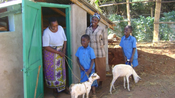 Boniface, fore, holds Saki and Charles has Shaanti and their grandmother